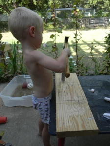 My Dad sent me some chisels and a plane. Young Grasshopper was really excited to try them out.